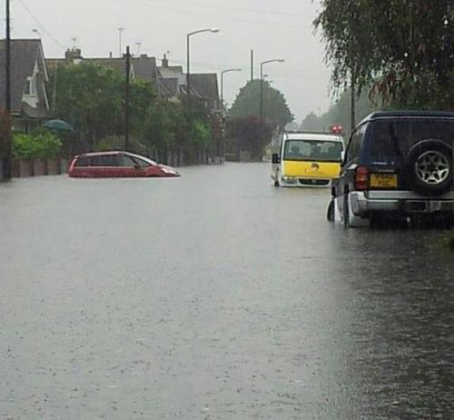 SUBMERGED: A soggy road in Felpham, Bognor this afternoon. Picture by Sussex Police