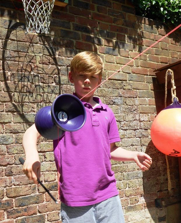 Ten-year old Oscar Dudley performing a diabolo trick