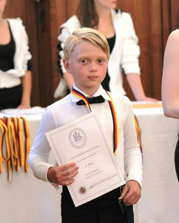 Oscar receiving his award at the Cologne competition