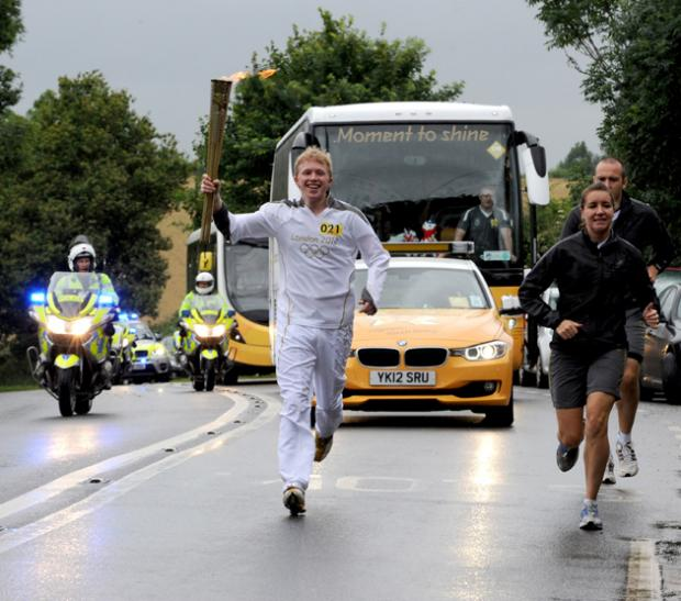 IT'S HERE! The torch arrives in Rogate, Sussex this morning