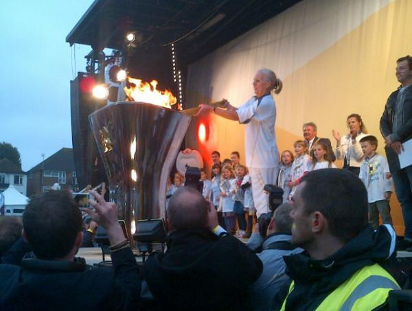 Karen West, 60, a nurse from Worthing lights the Olympic cauldron at Sussex County Cricket Ground in Hove.