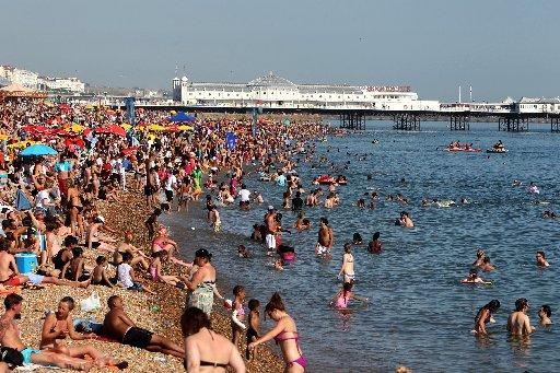 Sunny weather brought the crowds to Brighton beach on Wednesday, July 25