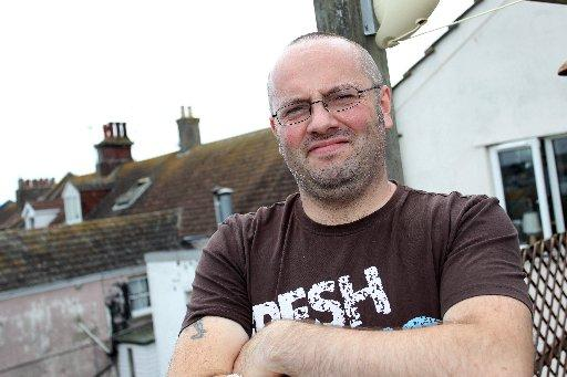 Wayne Hemmings clambered out of an attic window to save a terrified dog on a roof