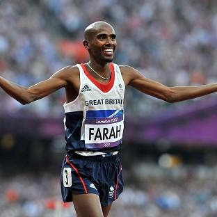 Great Britain's Mo Farah celebrates after winning the Men's 5000m Final