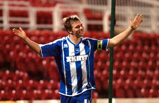 Great days: Dean Hammond celebrates a goal for Albion at Swindon in 2007