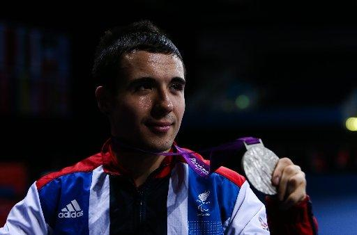 Will Bayley shows off his silver medal