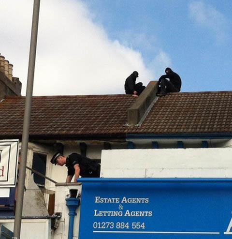 Police and squatters on the roof of the building in London Road during a stand off in September
