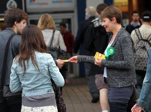 Brighton Pavilion MP Caroline Lucas handing out flyers against rail fair increases at Brighton Station in August