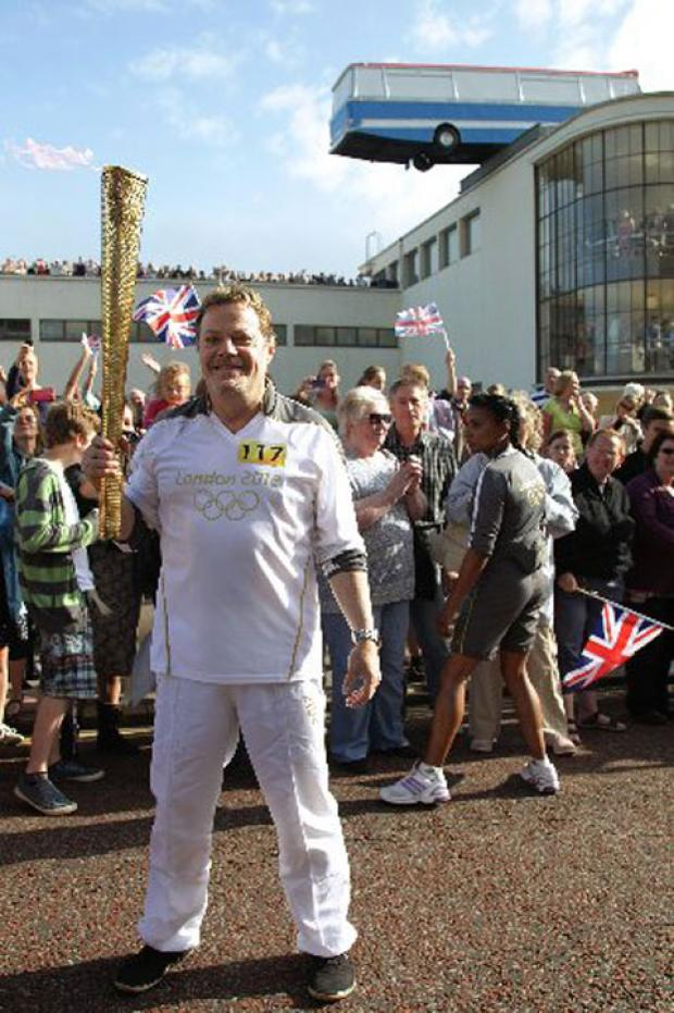 Eddie Izzard outside the De La Warr Pavilion in Bexhill, during the Olympic Torch Relay