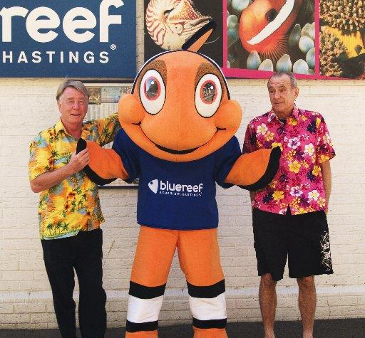 Rick Parfitt and Francis Rossi with Blue Reef mascot Charlie