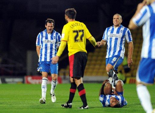 Gordon Greer and Adam El-Abd make a point after Liam Bridcutt was fouled at Watford