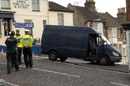 Police at the accident scene in Bear Road, Brighton, today