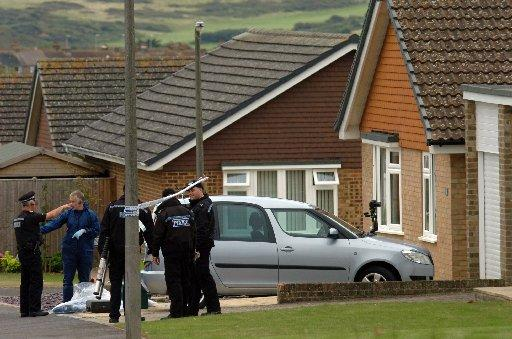 Police work at the scene in North Way