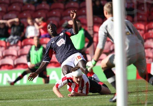 Jonathan Forte goes for goal at Griffin Park