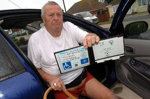 Michael Gilbert with his out-of-date blue badge