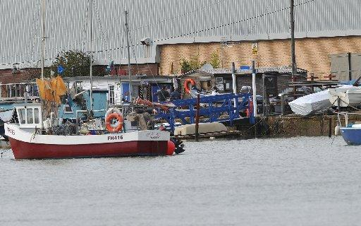 The emergency services were called out to help houseboat owners in Surry Boat Yard