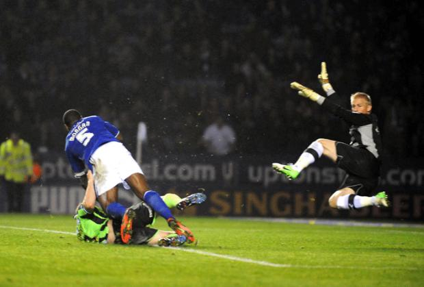 Schmeichel thwarts Ashley Barnes from the penalty spot and his follow up (photo Simon Dack)