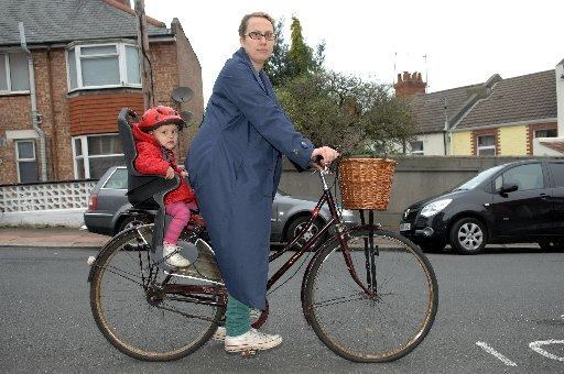 Rebecca Barkaway with daughter Florence on the back of her bike