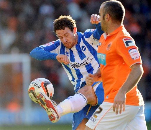 Wayne Bridge gets stuck in against Blackpool