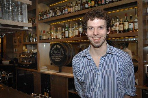 Barman Jason Rogers earns the minimum wage