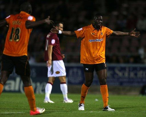 Bakary Sako celebrates a goal for Wolves