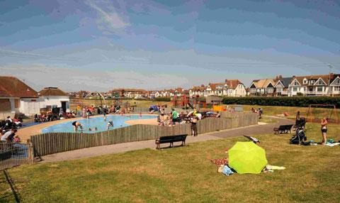 Families enjoying the sunshine at Hove Lagoon
