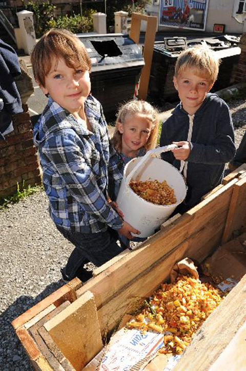 Youngsters at St Luke's using the new compost bins