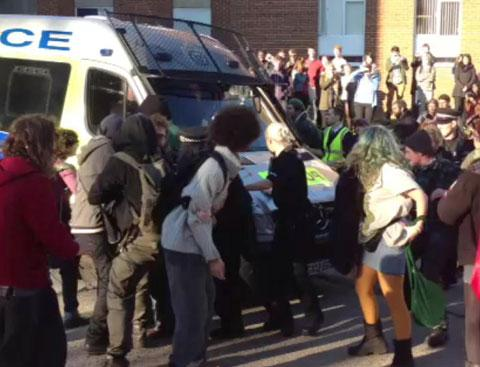 Protesters at University of Susssexmob a police van where Hove MP Mike Weatherley took shelter