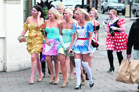 Women dressed up for a hen party in Brighton