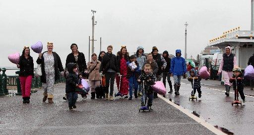 Parents and children from Little People by the Sea Nursery walking from Hove Lagoon to Brighton Pier