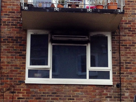 Woman fights for life after Brighton flat fire