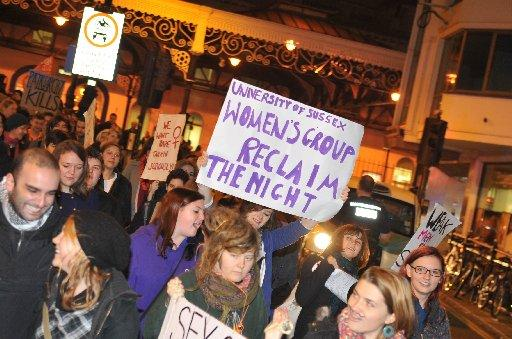 People gather outside Brighton Station for the Reclaim the Night protest