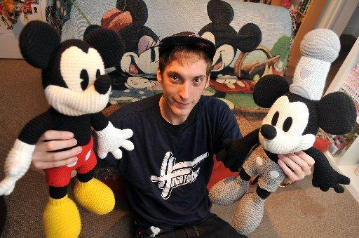 Ben Whitmore with two of his Disney toys going up for auction