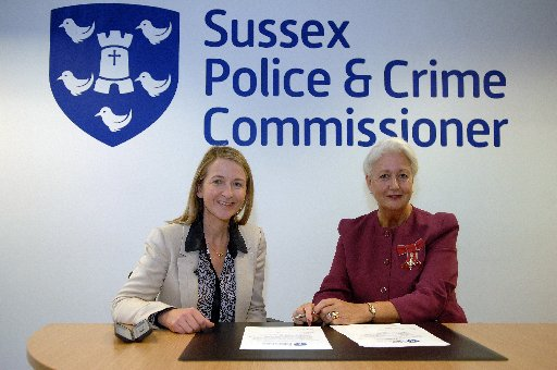 Katy Bourne newly elected Sussex Police and Crime Commissioner signs the Oath Of Impartiality marking her first day in office. Pictured with Carole Shaves vice chairman of Sussex Police Authority
