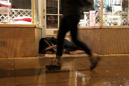 A rough sleeper in a shop doorway in Brighton