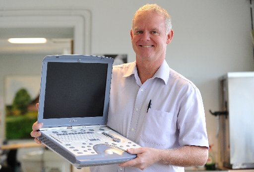 Worthing Hospital cardiac manager Stephen Copeland with the scanner