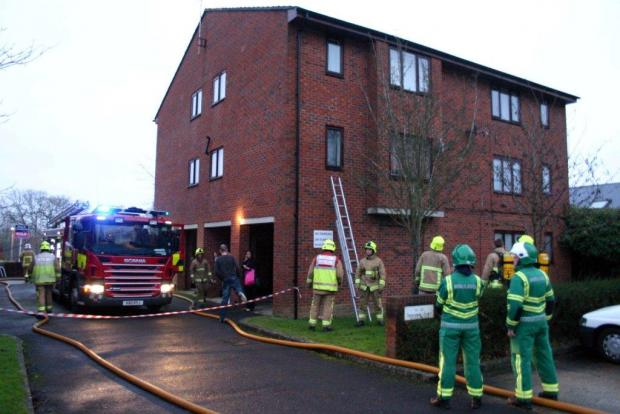 Eight rescued after fire in flats in Crawley
