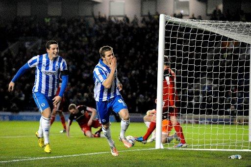 Dean Hammond celebrates his goal at The Amex last night. Picture by Simon Dack