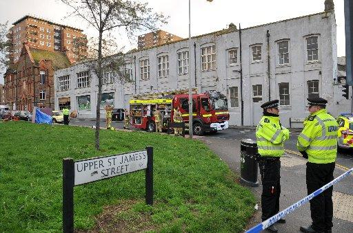 Police and firefighters at the scene in St George's Terrace, Brighton