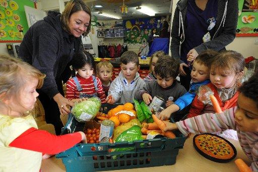 Children at Puffin nursey discover what is in the latest delivery from FareShare