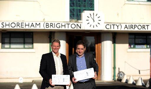 Entrepreneurs Neil Laughton and Jonathan Candelon outside the airport building