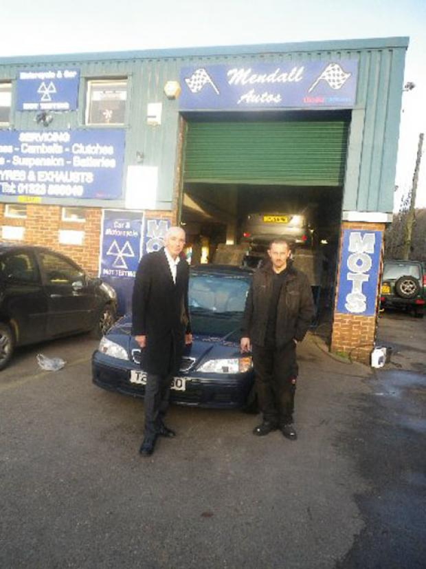 John Backshall, left, with mechanic Joe Mendall and the Honda Accord which choked to a halt because of contaminated petrol