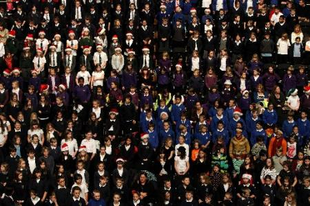 More than 1,200 primary school children from Brighton and Hove delighted family and friends at a massed carol concert at the Brighton Centre