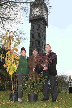 Sarah Carlisle, team leader for Stanmer Nursery, Max Glaskin, chairman of the Friends of Blakers Park celebrate with councillor Pete West – Image by Southern News and Pictures