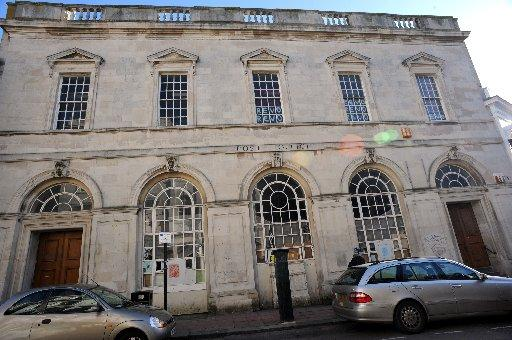 TGI Friday's has pulled out of plans to redevelop the old Post Office as squatters have moved in