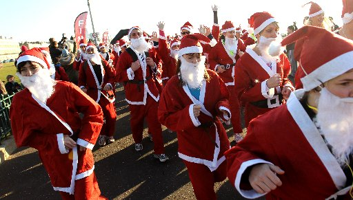 Santa runners at the start of the 5K race