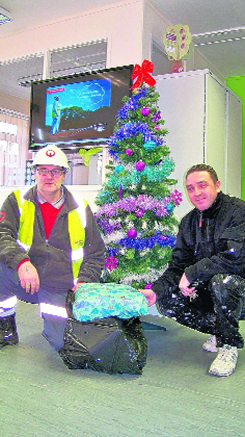 Danny Kent thanks Paul Young from Veolia Environmental Services for recovering the presents