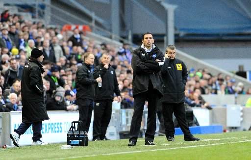 Gus Poyet watches the action against Forest