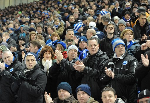 Fans applaud Brighton and Hove Albion during their game against Nottingham Forest