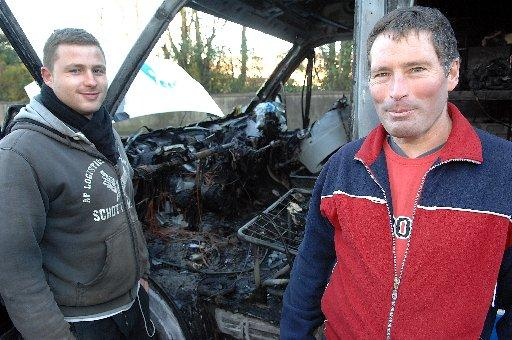 Jordan Murray and Steven Gumbrell with the remains of their van